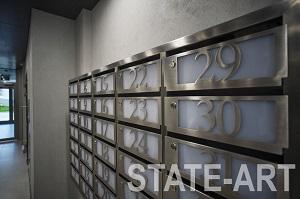 Вид на фасады секций настенного почтового блока